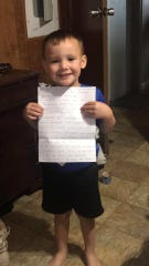 Raiden Meche, a pre-K student at Charles M. Burke Elementary, holds up the letter he received from his Spanish immersion teacher Julia Lopez while schools are closed due to the COVID-19 pandemic.