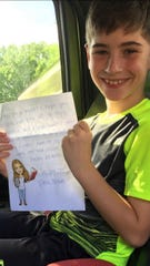Russell Earles, 9, is one of 39 third-graders to receive letters from Raegan Abshire, a student teacher at Charles M. Burke Elementary. She used letters to encourage students to read and to connect to her students while schools are closed during the COVID-19 pandemic.