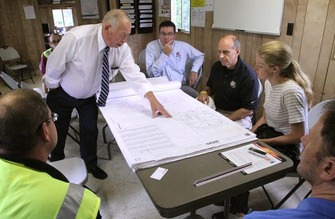 County Commissioner Dennis Dolan and other officials review floor plans for the Livingston County Jail expansion in June of 2015.