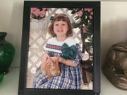 Features columnist Maggie Menderski in the dress her mother picked out for her fifth birthday.