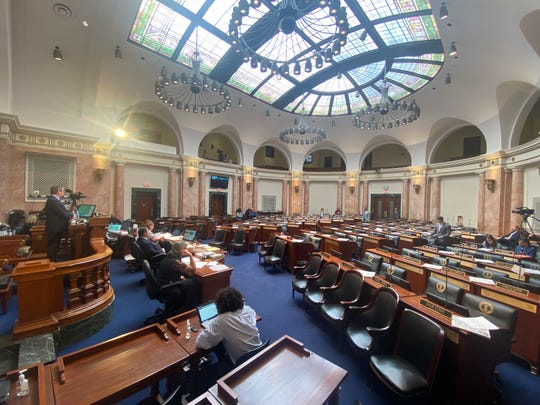 The Kentucky House voted on a bill Wednesday in a nearly empty chamber, following new rules being adopted to allow members to cast a vote remotely due to concerns over the coronavirus.