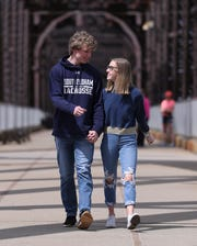 Colby Rupp, 18, left, and his girlfriend Sadie Rodell, 17, hold hands as they walked along the Big Four Bridge this week.