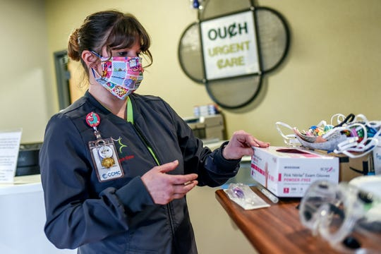 Registered medical assistant Christina Caldwell arranges medical supplies at OUCH Urgent Care on Tuesday, March 31, 2020, in St. Johns.
