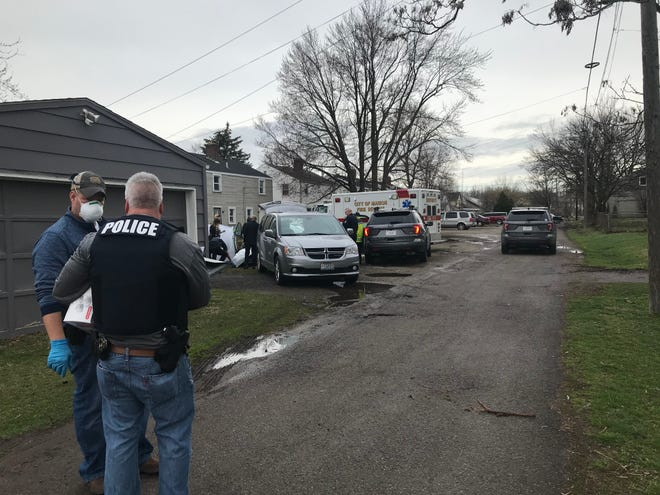 The Marion Police Department sent investigators to a house on Universal Avenue, behind which two people were found dead March 27 of suspected carbon monoxide poisoning.