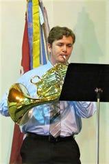 Logan Fischer on French horn.