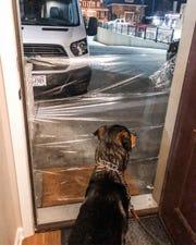 Austin Kahly and his fiance, Hannah Churchill, of Cudahy Saran-wrapped their neighbors' doorway as a prank.