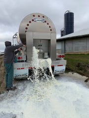 Golden E Dairy near West Bend has been forced to dump 25,000 gallons of milk a day as the coronavirus pandemic slams the fragile dairy industry.