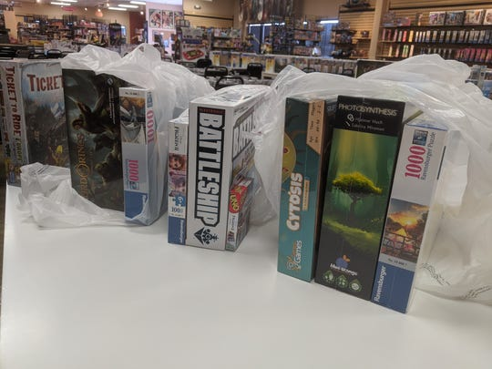 These games from Board Game Barrister are ready to be delivered, along with food from Oak & Shield Gaming Pub, to customers during the coronavirus pandemic.