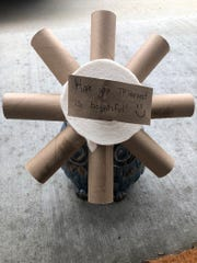 """When the Ahmads of Cudahy woke up on April Fools' Day, they were greeted by aflower crafted out of empty toilet paper rolls and a full roll with a card attached that said, """"Hope your TP harvest is bountiful."""""""