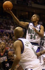 Ray Allen soars to the basket while all Philadelphia 76ers Eric Snow can only watch during the first quarter of their game  June 1, 2001 at the Bradley Center.