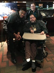 Tony Cerniglia and his sister, Katy Bechtel, got to meet Milwaukee Bucks superstar Giannis Antetokounmpo during a season ticket holder event several years ago at Dave & Buster's. Since the Eisenhower Center closed because of the coronavirus outbreak, Cerniglia is isolated in a room at his group home. His sister says he misses going to Bucks games.