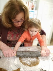 Marianne Baseheart rolls out dough with her granddaughter, Aiofe.