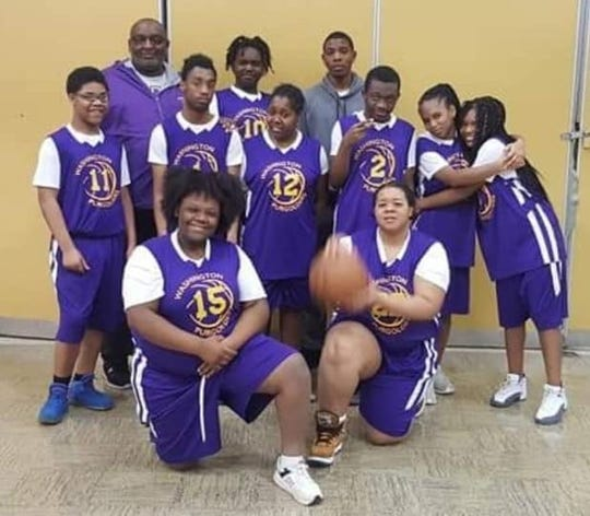 Ralph Davis (rear left) poses with one of the teams he coached during his 25 years at Milwaukee Washington High School.