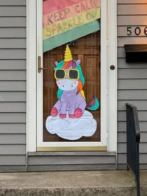 """A rainbow-colored unicorn reminds Whitefish Bay residents to """"Keep calm, sparkle on"""" from the doorway of this Whitefish Bay home. The Whitefish Bay Recreation and Community Education Department is organizing a contest to encourage people to upload their window art to social media."""