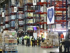 Team members meet and get assignments at the Roundy's Supermarkets distribution center in Oconomowoc on Wednesday.