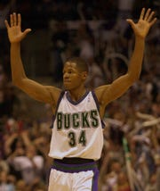 Milwaukee Bucks guard Ray Allen reacts after hitting a three-pointer during the second quarter of their game against the Philadelphia 76ers Friday, June 1, 2001 at the Bradley Center in Milwaukee.