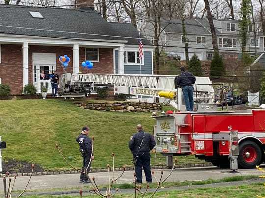 The Barter's welcome the Morristown and Morris Township fire departments as they surprise three-year-old Jason Barter on his birthday.