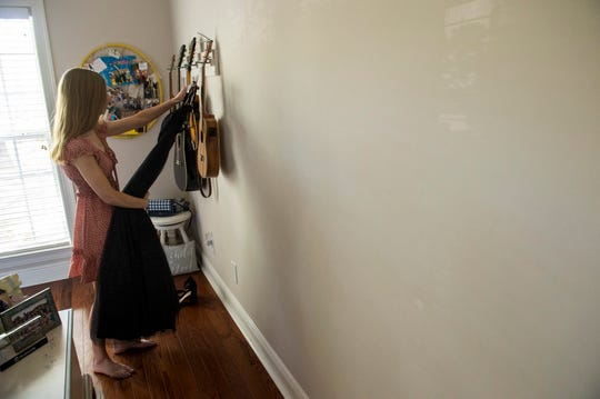Savannah Nelson, a junior at Prattville Christian Academy, grabs her prom dress from her room at her home in Prattville, Ala., on Wednesday, April 1, 2020.