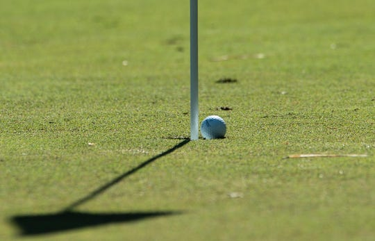 A ball rolls out of a shortened hole at Lagoon Park golf course in Montgomery, Ala., on Wednesday, April 1, 2020. The holes depth has been shortened for sanitary reasons.