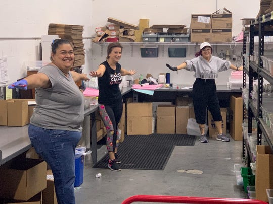 Naples Soap Co. is seeing more online orders for its soap and self-care products amid the coronavirus epidemic. This photo, taken April 1, 2020, shows orders being processed at its warehouse in Fort Myers, with employees keeping a safe distance.