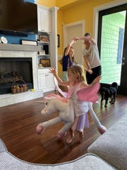 Cassie Barone and her daughters get some aerobics with an impromptu dance session while all are at home.