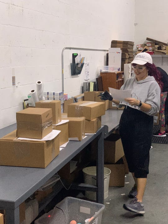 Naples Soap Co. is seeing more online orders for its soap and self-care products amid the coronavirus epidemic. This photo, taken April 1, 2020, shows orders being processed at its warehouse in Fort Myers.