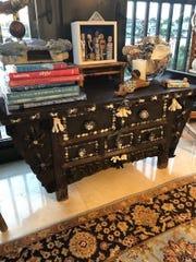 Sharon Johnson of Naples gave a dark wood cabinet some sea life ornamentation.
