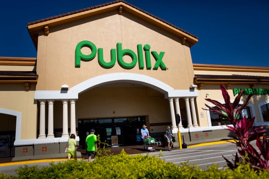 Shoppers make grocery runs at Publix in Bonita Springs on Wednesday, April 1, 2020.