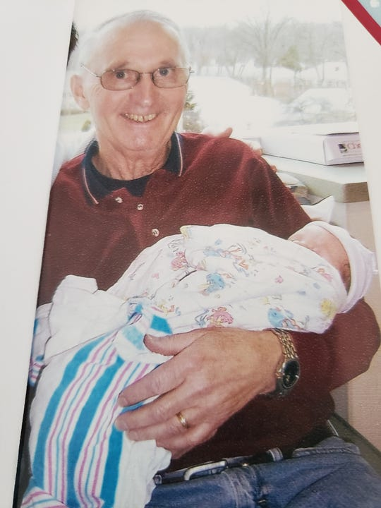 Art Olsen in 2009 holding his grandson Isaac. Olsen died on April 1 after being diagnosed with COVID-19 at the  Phoenix Center for Rehabilitation and Pediatrics in Haskell, N.J.