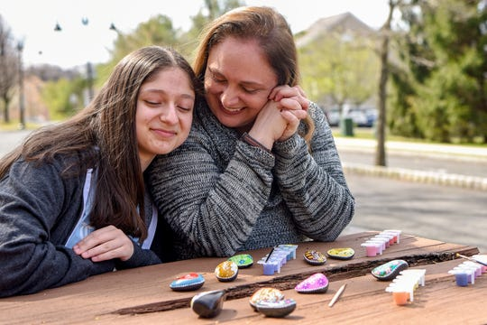Cecilia Soheily and her mother, Brenda Pillari, take a break from painting encouraging messages on stones — a project that has raised the spirits of their neighbors in North Haledon during the coronavirus pandemic.