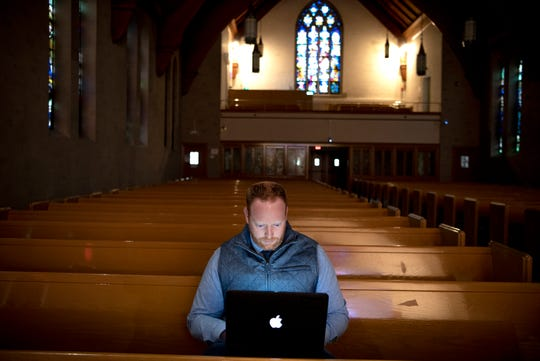 Bethlehem Lutheran Church in Ridgewood is live streaming worship services during the coronavirus pandemic. Pastor Matt Peeples montiors real time prayer requests and chats on YouTube during the service on March 22, 2020.