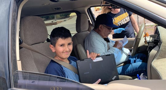 A Buena Vista Elementary Student gets his Chromebook during Cromebook checkout April 1.  Alamogordo Public Schools began Chromebook checkout Wednesday, April 1 and will continue checking out Chromebooks to students through April 3.