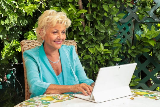 Dr. Judi Hollis sits on her patio where she participates in Zoom video meetings during the stay-at-home directive put in place to slow the spread of coronavirus on Wednesday, April 1, 2020 in Palm Springs, Calif.