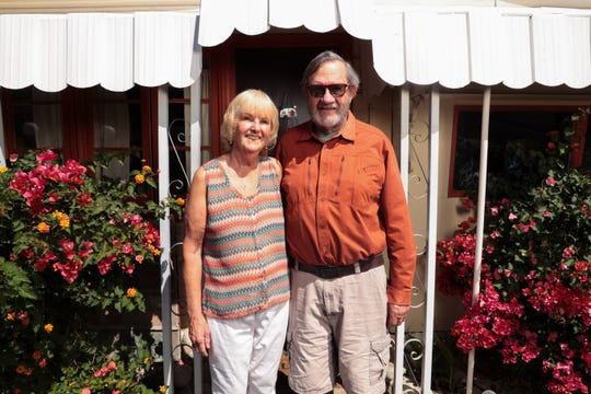 Pat and Doug Harbo stand in front of their home in Palm Springs, Calif., on Wednesday, April 1, 2020, after deciding not to head to their vacation home in Lake Tahoe during the stay-at-home directive put into place to slow the spread of coronavirus.