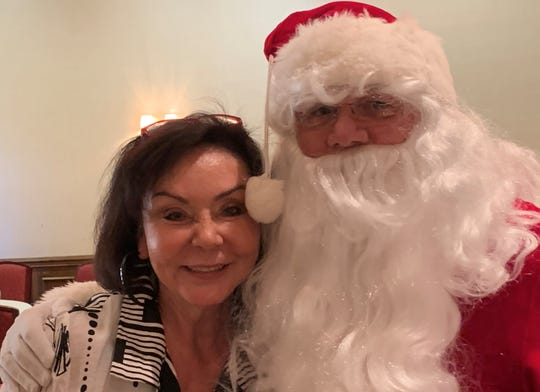Desert Arc volunteer Ernie Rubin shares a moment with Santa Claus at the 2019 holiday giving luncheon for Desert Arc clients.