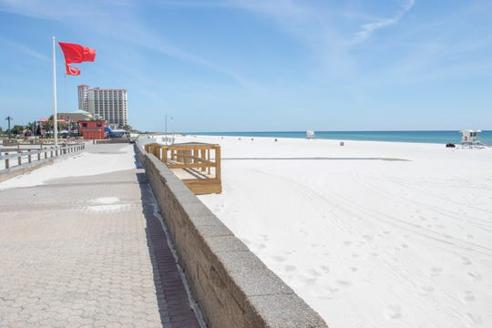 The area is deserted during the coronavirus shutdown at Casino Beach in Pensacola on Wednesday, April 1, 2020.