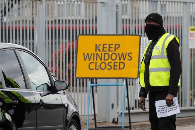 National Health Service staff wait in their cars to take a coronavirus test at a drive through centre in north London, Wednesday, April 1, 2020. The new coronavirus causes mild or moderate symptoms for most people, but for some, especially older adults and people with existing health problems, it can cause more severe illness or death.
