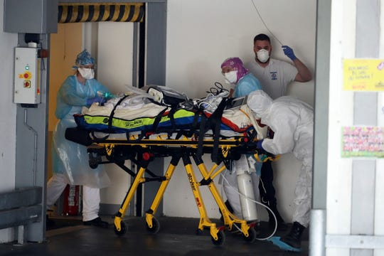 A patient infected with COVID-19 is admitted in a hospital on April 1, 2020, in Rennes, western France.