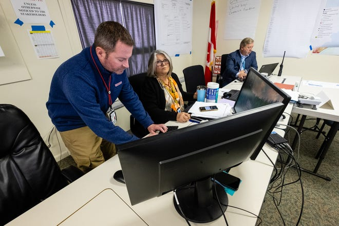 St. Clair County Emergency Management Director Justin Westmiller, left, works with Dr. Annette Mercatante, medical health officer for the St. Clair County Health Department, at the county's emergency operation center Wednesday, April 1, 2020.