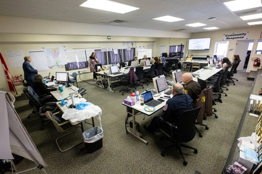 County staff work together to monitor the coronavirus pandemic in the county's emergency operations center Wednesday, April 1, 2020.