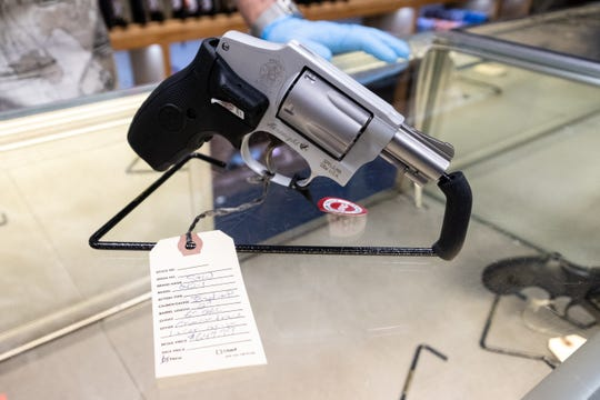 A Smith & Wesson .38 Special with a laser grip is on display on the counter at The Hock Shop Wednesday, April 1, 2020, in downtown Port Huron. Daniels said he's seen an increase in easy-to-use guns and first-time gun buyers during the coronavirus lockdown.