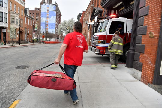 York City businessman Marc Unger delivers pizza from Anza's Pizza to York City Fire Station #1, Tuesday, March 31, 2020. The pizzeria is showing their support for first responders by providing free pizza this week to the firefighters and police officers as well as local hospitals.John A. Pavoncello photo