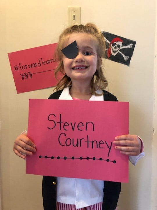 Alyssa Morrow, 5, daughter of York Suburban second grade teacher Lexi Morrow, holds up a sign in preparation for children's musician Steven Courtney to perform his pirate song on Friday. Courtney will be performing a virtual concert for students on Friday, April 3, 2020.