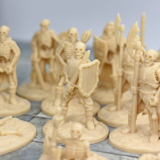 Griffon Co. typically makes Dungeons and Dragons game pieces, pictured here, but instead is temporarily making protective gear for medical care providers during coronavirus pandemic.