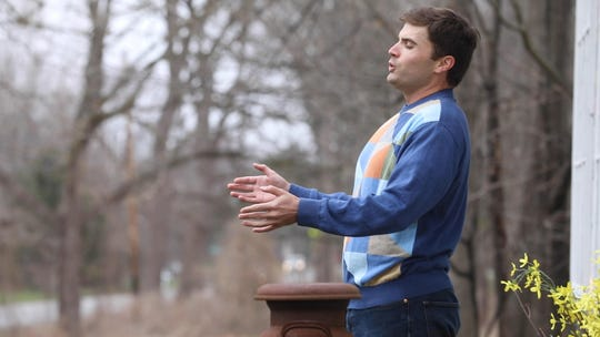 """Andrew Surrena performs an opera song every day at 5 p.m. on the porch of his future in-law's home in Pittsford.   Tuesday, March 31, 2020 he had a small audience as he sang, """"La Donna E Mobile."""""""