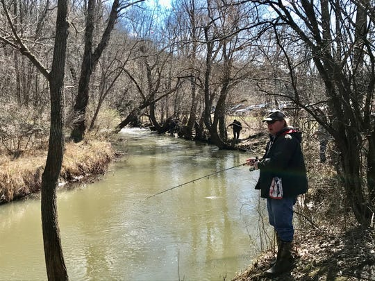 Eddie Crompton, 62, of Rochester has been fishing Irondequoit Creek since he was 10. He was enjoying Opening Day of trout season amid the coronavirus pandemic that kept crowds down. 'As long as I'm not near anyone I'm fine,' he said.
