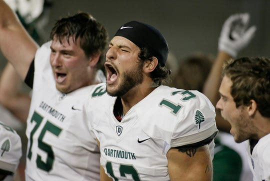 Dartmouth's Jared Gerbino (13) celebrates after he scored the winning touchdown at the end of an NCAA college football game against Penn on Friday, Sept. 29, 2017, in Philadelphia. Dartmouth won 16-13.