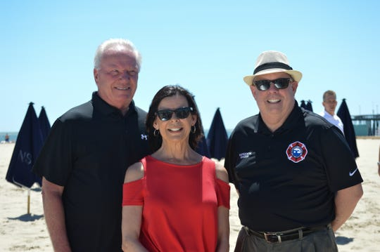 From left: Ocean City Mayor Rick Meehan, former Ocean City Tourism Director Donna Abbott and Maryland Governor Larry Hogan stand on Ocean City's beach.