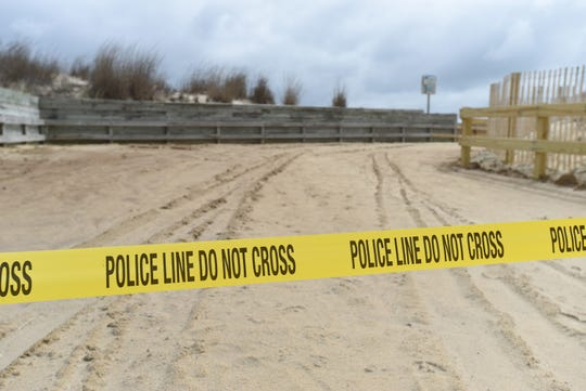 Police tape blocks the entrance to the beach at 40th Street in Ocean City on Wednesday, April 1, 2020.