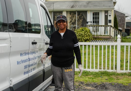 Brenda Milbourne helps deliver lunches prepared by Cape Henlopen School district to kids in West Rehoboth and surrounding neighborhoods on Monday, March 30, 2020.